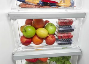 Images of an open refrigerator with fruits