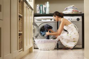 Image of a person removing clothes from the dryer