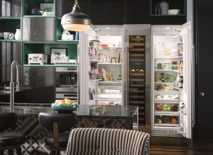 Image of a kitchen with an open refrigerator
