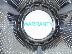 Close up image of dryer with a warranty label in the center